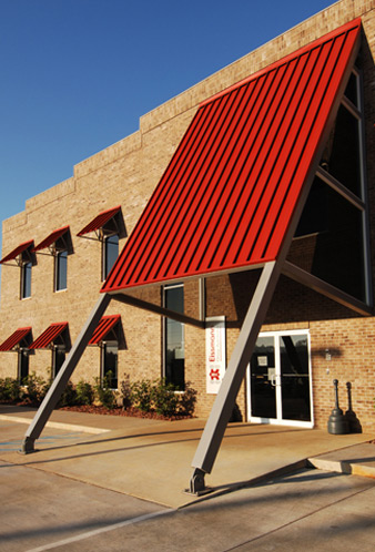 exterior detail of front entrance to Eissmann Automotive building